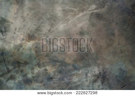 Abstract grunge texture of old stone wall with water splashes and mold spots, greenish and gray in color.