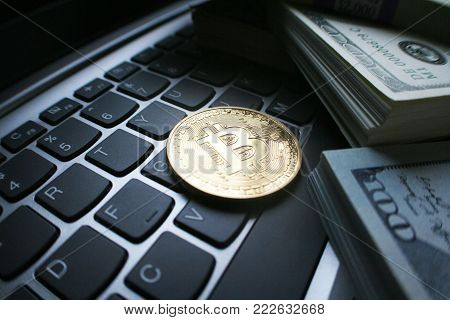 Gold Bitcoin On Computer Keyboard With Money Stock Photo