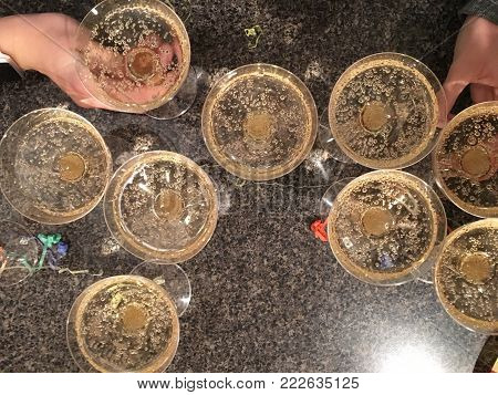 Champagne, Martinelli sparkling cider glasses from above on counter. Party and holiday celebration concept. New Years.