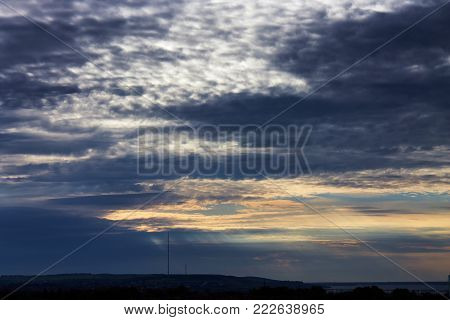 Dramatic cloudy sky with cirrus clouds at sunset.