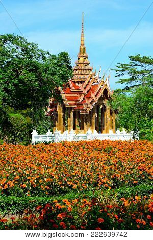 Beautiful pavilion Thai style temple  has a flower garden  front in  public parkland Suan Luang R.9 in Bangkok Thailand