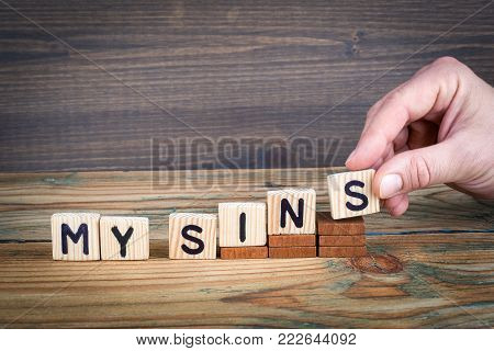 my sins. Wooden letters on the office desk, informative and communication background.