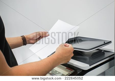 close up businessman with waist watch hold paper sheet for printer copying and scanning