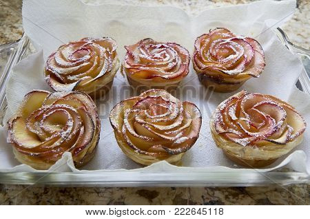 Homemade Apple Rose Puff Pastry with powdered sugar.