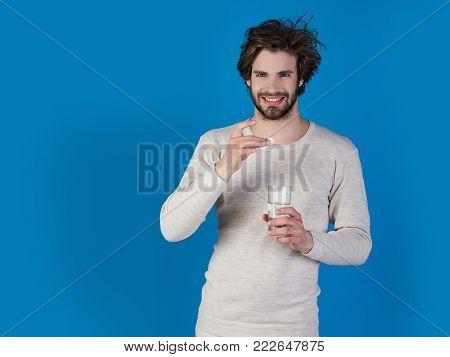 Man With Pills In Blister Pack.