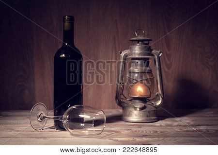 Still Life Photo Of Wine Bottle And Glass