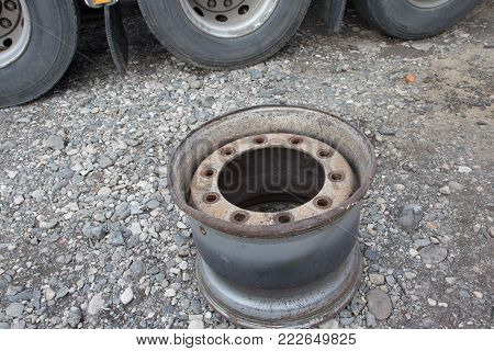 large wheel rim lugs nuts on metallic iron wheel surface of a heavy duty vehicle transport bus and truck