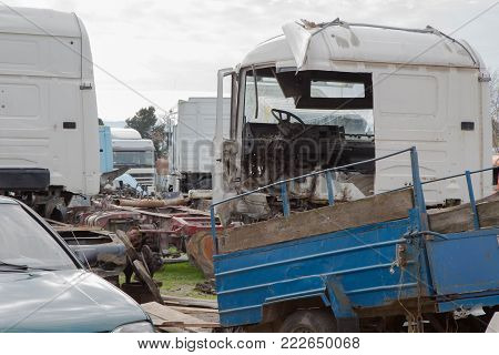 The old truck graveyard. Old and abandoned trucks. Interior of abandoned old car