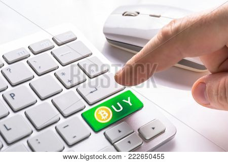 Buy bitcoin currency button on computer keypad