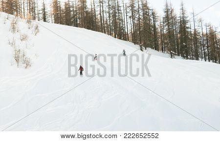 Off piste skiers near Sauze D'Oulx piedmont Italy