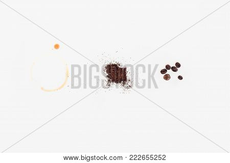 top view of roasted coffee beans, freshly ground coffee and spilled coffee drink isolated on white