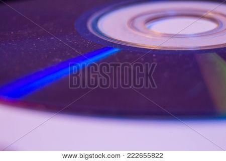 Macro Closeup Of Compact Cd Or Dvd Disc In Violet Color.