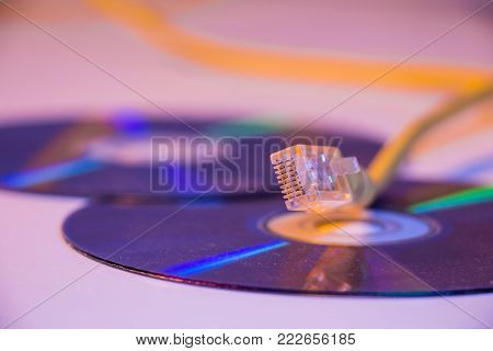 Closeup of Ethernet cable with it's reflection on blank disc.