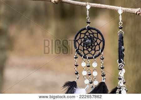 earrings Dream catcher with feathers threads and beads rope hanging. Dreamcatcher handmade