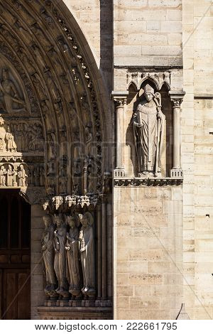 Architectural details of the facade of catholic cathedral Notre Dame de Paris. Notre-Dame cathedrall is built in French Gothic architecture. Paris, France
