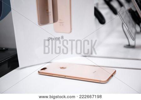 KYIV, UKRAINE - NOVEMBER 6, 2017: iPhone 8 Plus Gold on shelf in store