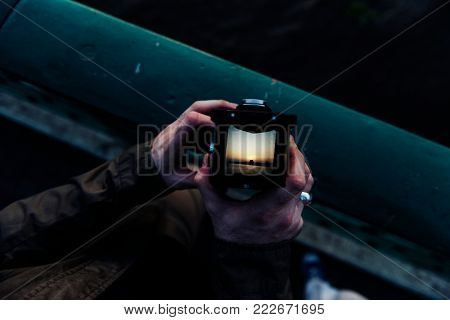 Closeup of hand holding camera