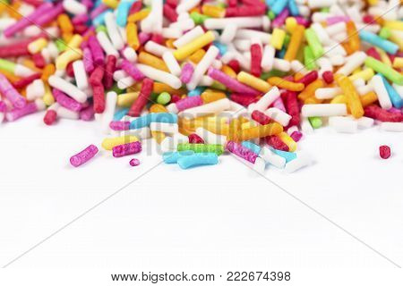 Colorful sugar sprinkle dots, decoration for cake and bakery, a lot of confectionery sprinkling