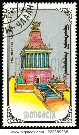 Ukraine - circa 2018: A postage stamp printed in Mongolia show Mausoleum of Hallcarnassus. Series: 7 Wonders of the Ancient World. Circa 1990.