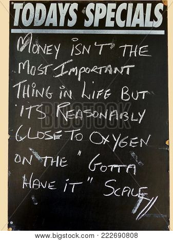 An amusing Sign depicting the value of money compared with oxygen in life