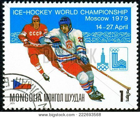 Ukraine - circa 2018: A postage stamp printed in Mongolia show hockey. A players in the uniform of Czechoslovakia, USSR. Flag Czechoslovakia. Series: Moscow ice hockey world championships. Circa 1979.
