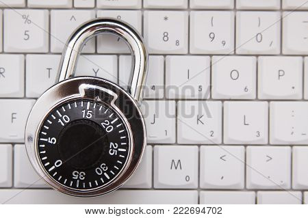 A combination lock on a computer keyboard concept.