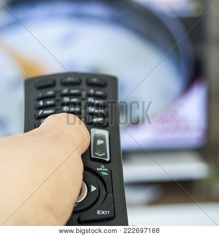 to relax at home and watch television, do zapping with the remote control, the people working at home to watch television hobbies,