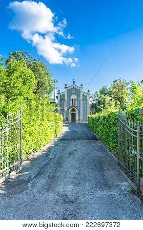 small San Venanzio Abate rural church in Busana, Emilia Apennines, Italy poster