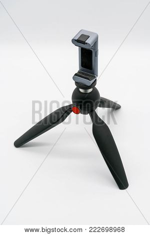Mobile phone clamp on mini Tripod with ball head isolated on white background