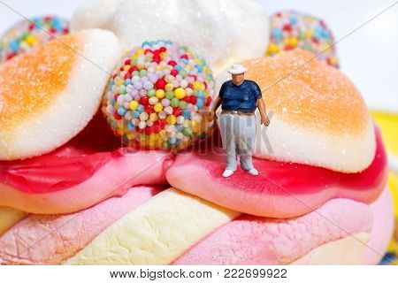 Fat Boy Miniature Figure Standing Amongst Candies