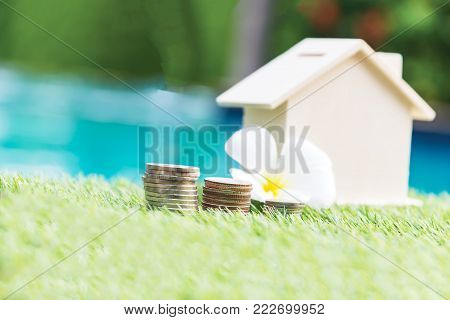 save money for future.Saving money for the future, saving money to buy a home in the future has a coin placed in front of the house with a blurry background. Business development concept