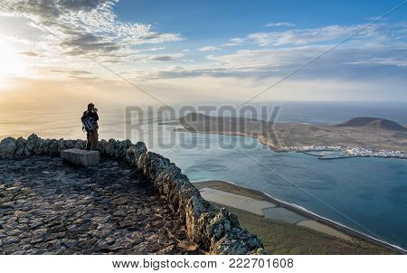 Lanzarote, Spain - December 26, 2016: Unidentified Tourists Takes Pictures Of Atlantic Ocean And La