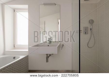 Modern bathroom with floor tiles. Nobody inside