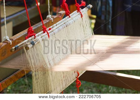 Household weaving - Close up Detail of weaving loom for homemade silk to or textile production of Thailand