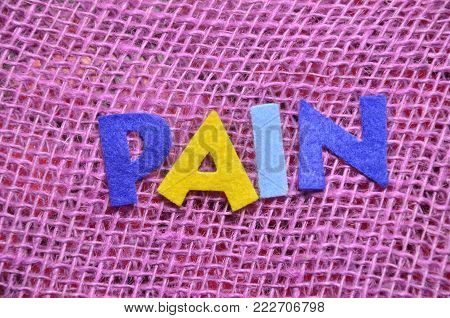 word pain on an   abstractb colored background