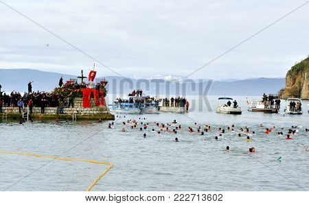 Ohrid, Macedonia - January 19, 2017: Men Swim In The Cold Water To Retrieve The Cross At The Epiphan