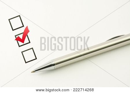 survey template, questionnaire choice, marked check box with a pen on paper background closeup