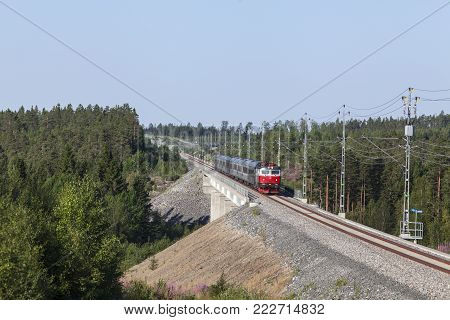 NORTH COUNTY, SWEDEN ON JULY 25. Long-distance train heading north on July 25, 2014 in North County, Sweden. Modern track through the countryside. Editorial use.
