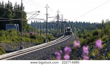 NORTH COUNTY, SWEDEN ON JULY 25. Intercity train heading south on July 25, 2014 in North County, Sweden. Modern track through the countryside. Editorial use.