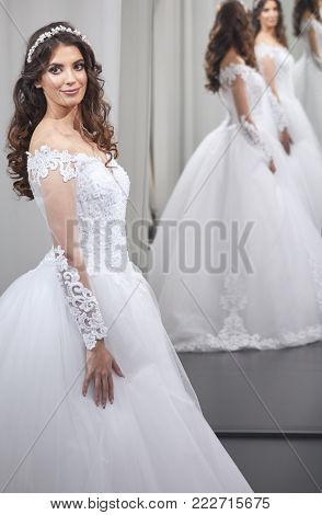 satisfied young bride, one person, looking at self, in mirror, happy