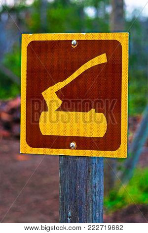 A firewood area sign at a campground.