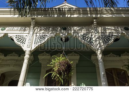 Detail of the facade of a colorful wood house in the Marigny neighborhood in the city of New Orleans, Louisiana, USA