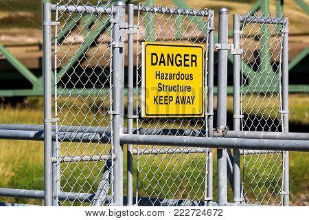 A Danger Hazardous Structure Keep Away sign.