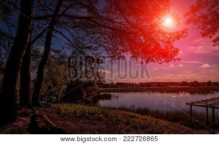 beautiful landscape. wonderful autumn sunset. sky with majestic clouds over the lake in the forest breathtaking scenery. fantastic picturesque scene. color in nature.