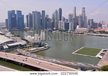 Singapore, Singapore - December 11, 2017. View over Marina Bay in Singapore, with Float stadium, ArtScience Museum and skyscrapers.
