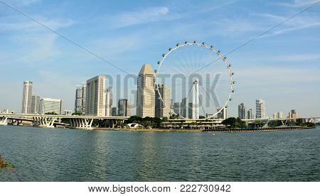 Singapore, Singapore - December 11, 2017. Skyline in Singapore with Singapore Flyer wheel and skyscrapers.