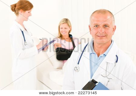 Medical Doctors With Hospital Patient Lying Bed