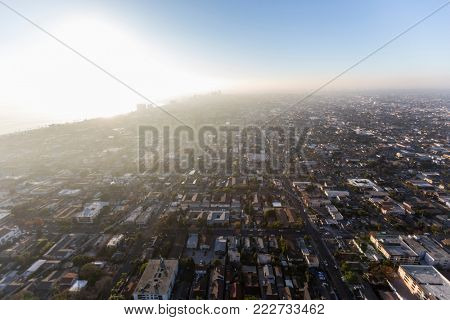 Aerial view of afternoon ocean fog rolling into Long Beach and Los Angeles in Southern California.