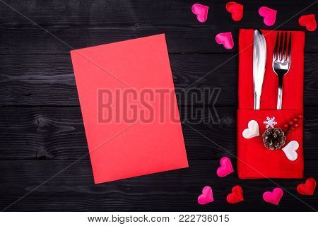 Valentines Day Table Setting With Fork, Knife And Red Dinner Napkin On Black Background,
