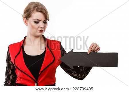 Healthy perfect female breast. Elegant girl witg black arrow sign showing her boobs unusual outfit. Dissatisfied woman present her body.